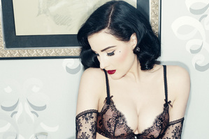 Dita Von Teese says she hopes to bring her burlesque striptease show to New Zealand.
