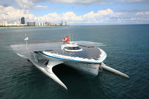 Kiwi-designed Turanor PlanetSolar on its attention-grabbing cruise up the River Thames in London.