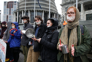 Protesters create a racket with pots and pans outside Parliament yesterday. Photo / Mark Mitchell