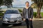 Jared Turner says his Honda Insight is fuel efficient, comfortable and has room for the family.Picture / Ted Baghurst