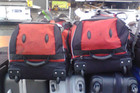 Never seen luggage so happy to be going on holiday. Snapped at Auckland International Airport, flight to Melbourne.