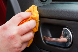 Use anti-bacterial wipes regularly on hot zones like door handles, gear knobs, steering wheels and even stereo controls.