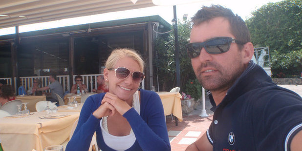 Andy Walker, pictured with wife Elizabeth, has been stood down from the Oracle America's Cup team after being found guilty of cheating by adding weight to their AC45 boat.