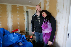 Karen and Scott Odell pose in their daughters' bedroom, which was contaminated by toxic paint during renovations in Whitby, Wellington. Photo / Hagen Hopkins