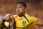 There have been calls for Israel Folau to be moved back to fullback - a position in which he has shone for the Waratahs. Photo / Getty Images