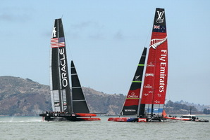 Emirates Team New Zealand sails past Oracle Team USA. Photo / Getty Images