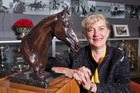 Frances Stead shows off the bronze sculpture of Jock Paget's Badminton winning horse, Clifton Promise. Photo / Mark Mitchell