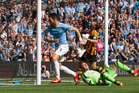Manchester City's Alvaro Negredo, centre, wheels away to celebrate after scoring past Hull's goalkeeper Allan McGregor, bottom right, during their English Premier League soccer match. Photo / AP