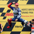 Jorge Lorenzo of Spain jumps on the podium after winning the MotoGP race of the British Grand Prix at left is Marc Marquez, and Dani Pedrosa right. Photo / AP