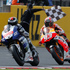Jorge Lorenzo of Spain, left, crosse the finish line ahead of countryman Marc Marquez to win the MotoGP race of the British Grand Prix at the Silverstone circuit in Silverstone, England. Photo / AP