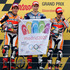Jorge Lorenzo of Spain holds a flag promoting Madrid's bid to hosts the 2020 Olympic Games, on the podium of the MotoGP race of the British Grand Prix at the Silverstone circuit. Photo / AP
