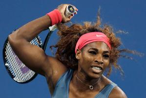Serena Williams showed no mercy to birthday girl Cala Suarez Navarro, winning, 6-0, 6-0. Photo / AP