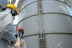 Japan's Trade Minister Toshimitsu Motegi wears protective gear to inspect Fukushima storage tanks. Photo / AP