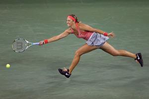 Victoria Azarenka, of Belarus, returns a shot to Daniela Hantuchova, of Slovakia, during a quarterfinal of the U.S. Open tennis tournament. Azarenka won 6-2, 6-3. Photo / AP.