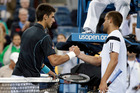 Novak Djokovic, Serbia, is congratulated by Mikhail Youzhny, Russia, after Djokovic defeated Youzhny in a quarterfinal match at the 2013 U.S. Open tennis tournament. Photo / AP.