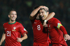 Portugal's Cristiano Ronaldo, right, reacts with Joao Moutinho, center, and Joa Periera after scoring a goal against Northern Ireland during their World Cup Group F qualifier. Photo / AP