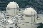 Reactors of No. 3, right, and No. 4 stand at Ohi nuclear power plant operated by Kansai Electric Power Co., in Ohi town, Fukui prefecture, western Japan. No. 3 was fully shut down today. Photo / AP