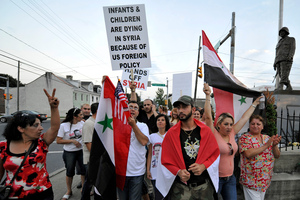 Members of the local Syrian community rally against the United States involvement in Syria in Pennsylvania. Photo / AP
