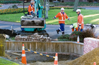 Contractors laying fibre optic cable as part of the nationwide ultra fast broadband rollout. Photo /  Stephen Parker