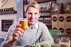 Moa's decision to fly former Australian cricketer Shane Warne into the country for a quick tour of its brewery has raised eyebrows.