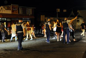 Figures show police are doing less of this: clearing Dunedin's Castle Street of naughty party goers. Photo / Otago Daily Times