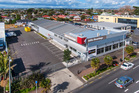 Exterior view of warehouse and showroom building for sale at 28-32 Atkinson Avenue and 25 Princes St, Otahuhu.
