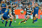 Hawkes Bay wing Telusa Veainu finds a gap in the Otago defence.  Photo / Otago Daily Times