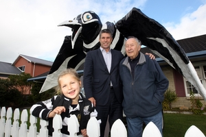 HAWKEYE CREW: Simon Tremain, who sparked the Hawkeye facelift, and Mela, his daughter (a Magpies fan) and Ian Mills, who designed the big bird 48 years ago. PHOTO/PAUL TAYLOR HBT132758-01