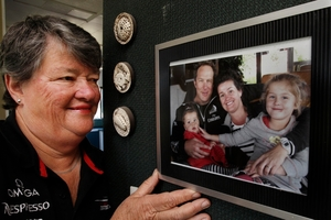 ONSHORE SUPPORTER: Sandra Easterbrook, whose son-in-law Chris McAsey is a grinder on Emirates Team New Zealand's AC72. In the framed picture are Chris, Sandra's daughter and Chris' wife Suzy, and their daughters Brooke and Billie. PHOTO/JOHN STONE