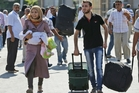 Syrian refugees flee into Turkey. The US says sarin gas was used in the Ghouta, Damascus, attack. Photo / AP