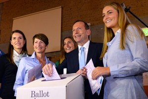Australia's conservative Coalition leader Tony Abbott (2nd R) votes with his wife Margie (2nd L) and daughters Louise (L), Frances (C) and Bridget (R). Photo / AFP
