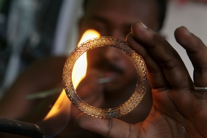 Demand for gold has surged in China and India. Photo / AP