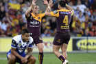 Scott Prince of the Broncos, left, celebrates victory in his final match in the NRL as Ben Barba is dejected. Photo / Getty Images