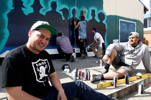 TIME OUT: Aku Hita and Abraham Sareet take a break from working on a mural at Kamo High School. PHOTO/JOHN STONE