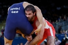 Kurban Kurbanov of Uzbekistan (in red) and George Gogshelidze of Georgia at the London Olympics last year. Wrestling is favoured to return in 2020. Photo / AP