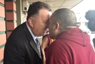 Labour leadership hopeful Shane Jones greets a local Buddhist in Whangarei. Photo / Claire Trevett