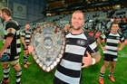 Chris Eaton holds the Ranfurly Shield in Dunedin after yesterday's win.