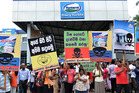 Activists demonstrating outside the Sri Lankan headquarters of New Zealand dairy giant Fonterra. Photo / AFP
