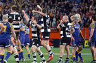 Magpies players celebrate winning the Ranfurly Shield while Hawkes Bay debutant Ben Franks, number 17 to the right, looks on. Photo / Getty Images