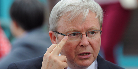 Kevin Rudd adjusts his glases as he speaks to aged care workers at St Laurence's Hostel. Photo / Getty Images