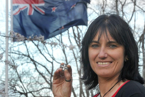 Tina Grant, New Zealand Army liaison officer for families of the fallen, holds a memorial cross brooch acknowledging the death of her husband, Corporal Doug Grant, in Afghanistan. Photo / Craig Baxter