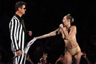 Robin Thicke performs with Miley Cyrus at the VMAs. Photo / AP