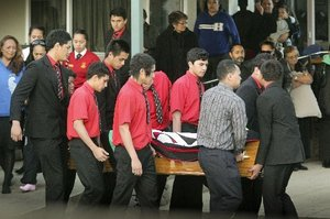 Te Aute college students carry fellow Te Aute student Wiremu Rawiri 17 casket at a memorial service held in Waipukurau.  Photo: Warren Buckland