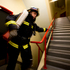 Firefighter Glenn Norman from Waitoa takes part in a stair challenge in the old BNZ Tower to commemorate the 911 terrorist attack on New York.  Photo / Dean Purcell