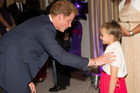 Prince Harry meets Madison Kirk, 6, at the annual WellChild Awards. Harry told the ceremony how much he loves being an uncle.Photo / AFP