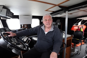 SHIPSHAPE: Brian Angliss on the bridge in his Arun class lifeboat 52-18. PHOTO/JOHN STONE