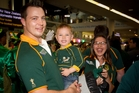 It's a family affair as Dolph Louw, 2-year-old Leo Louw and Anne Brichell greet the Springboks at Auckland International Airport yesterday. Photo / Sarah Ivey