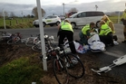 Emergency workers treat the cyclists at the site of yesterday's crash. Photo / Westpac Waikato Rescue Helicopter