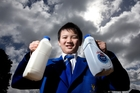 Tristan Pang, 11, says he found milk degraded faster in the triple-layer bottle than the single. Photo / Brett Phibbs