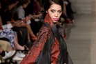 CATWALK: One of the raincoats by Leilani Rickard on stage in Auckland. PHOTOS / SUPPLIED